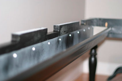 Hide wires with a rain gutter under your desk