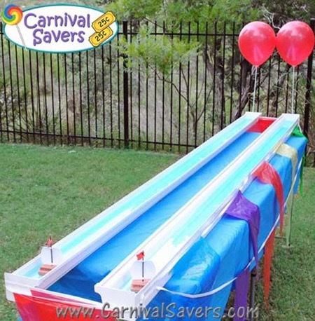 Sailboat race game with repurposed rain gutters